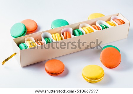 macaroons in the package on a light background