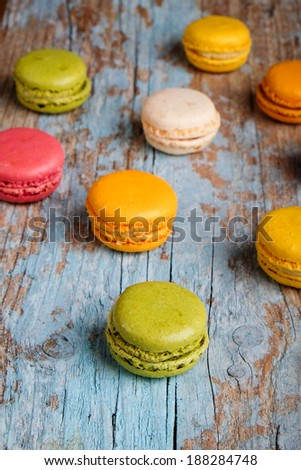 Macaroons on a wooden baclground - stock photo