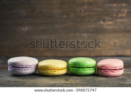 Macaroons on wood background with copy space