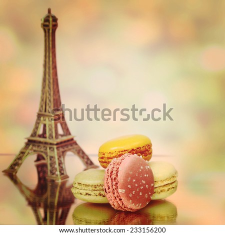 Macaroons traditional Parisian cookie nad Eiffel tower - stock photo