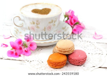 Macaroons traditional Parisian cookie with cup of coffee - stock photo