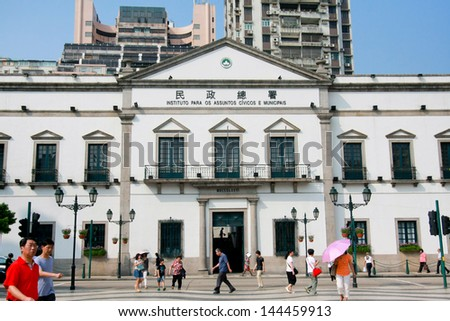 MACAU - AUG 27: People walking in front of the government office in the central of Macau city nearby the shopping arcade (Senedo square) on August, 27, 2012