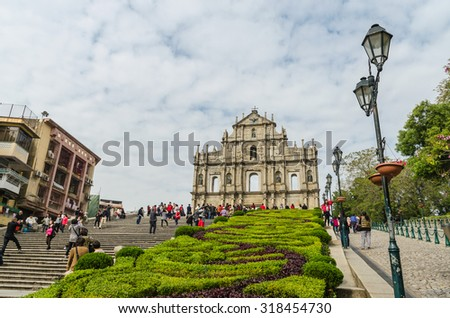 Macau, China - Jan 8, 2013: Ruins of st.paul's, One of macau's best known landmark. Some tourists sightseeing and taking pictures with the ruins - stock photo