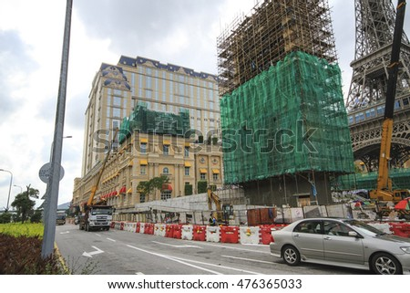 MACAU,CHINA - JULY 2 2016: Chinese workers builds new Casino in Maco. Gambling tourism is Macau's biggest source of revenue, making up about 50% of the economy.