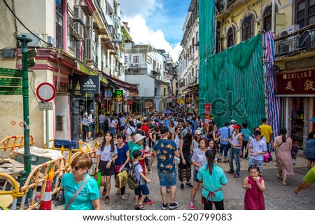 Macau, China - July 2nd. 2016 - The streets of downtown Macau in a busy day, blue sky and buildings around, Macau, China.