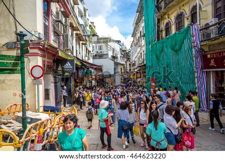 Macau, China - July 5th 2016 - Big concentration of people in the tourists areas of Macau downtown in summer, China.