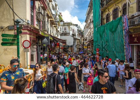 Macau, China - July 5th 2016 - Huge crowd concentration in the narrow streets of Macau downtown in Macau, China.
