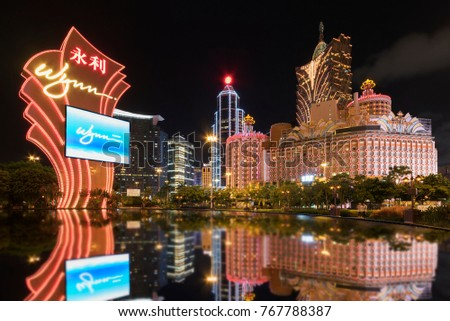 MACAU, CHINA - JUNE 30, 2016: Wynn Casino and Grand Casino Lisboa on June 30, 2016 in Macau. Macau is the world's top casino market and Casino Lisboa is one of the most well known casinos in the city.