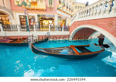 MACAU, CHINA - MAY 10, 2014: Interior of Venetian Casino in Taipa. The famous shopping mall, luxury hotel and the largest casino in the world