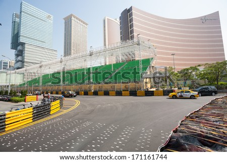 MACAU, CHINA - NOVEMBER 2, 2012: Safety barriers installed along streets before the upcoming racing Macau Grand Prix in stages Formula 3, FIA WTCC, motorcycle prize. Race takes place on the streets. - stock photo