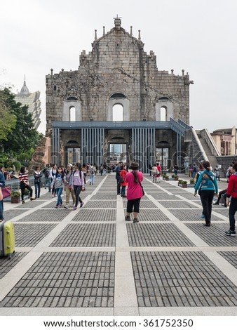 MACAU, CHINA - NOVEMBER 27, 2015: Tourists visiting Saint Paul's Cathedral. Built from 1582 to 1602, it was destroyed by a fire during a typhoon in 1835.  - stock photo