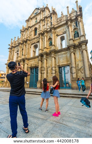 MACAU, CHINA - OCT 22: Visitors visit the Ruins of St. Paul's. Built from 1602 to 1640, one of Macau's best known landmarks. In 2005 - stock photo