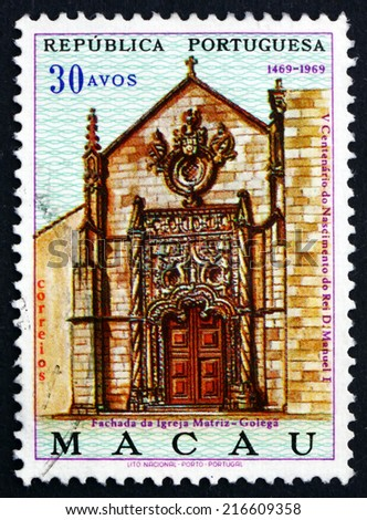MACAU - CIRCA 1969: a stamp printed in the Macau shows Portal of Mother Church, Golega, 500th Anniversary of the Birth of King Manuel I, circa 1969 - stock photo