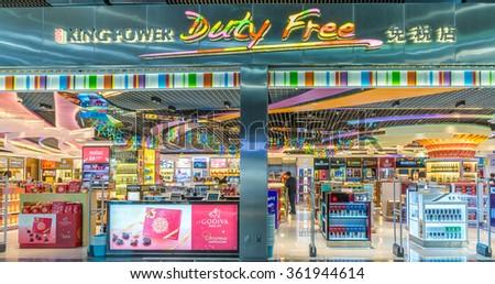 MACAU - DECEMBER 1, 2015: King Power Duty Free Macau, Shilla, Sky Connection store at Macau International Airport Terminal sells liquor, tobacco, chocolate, jewelry, perfume, cosmetics, local products - stock photo