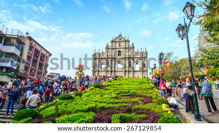 Macau - February 17, 2015: Ruins of St. Paul's. People are visiting. Built from 1602 to 1640. In 2005, they were officially listed as part of Historic Centre of Macau, a UNESCO World Heritage Site. - stock photo