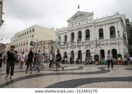 MACAU-JAN 16 : Tourists visit the Historic Center of Macao on Jan 16, 2013 in Macau, China. The Historic Centre of Macao was inscribed on the UNESCO World Heritage List in 2005. - stock photo