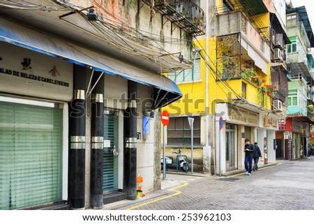 MACAU - JANUARY 30, 2015: Streets of the historic centre of Macau. Macau is a popular tourist attraction of Asia and leading casino market of the world.