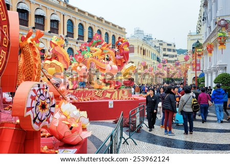 MACAU - JANUARY 30, 2015: The Senado Square in the historic centre of Macau decorated for the Chinese New Year, for the Spring Festival. Macau is a popular tourist attraction of Asia in the holidays. - stock photo