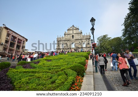 MACAU-NOVEMBER 19 : Tourists visit the ruined church of St Paul on 19 November 2014 in Macau, China. The ruined church of St Paul was inscribed on the UNESCO World Heritage List in 2005.  - stock photo