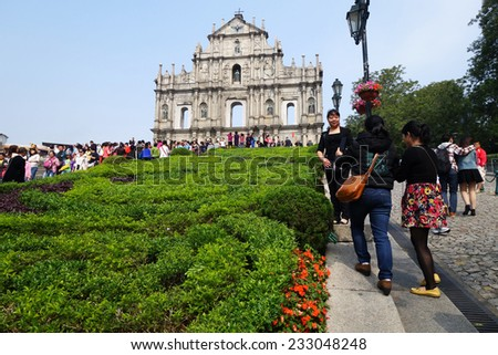MACAU-NOVEMBER 19 : Tourists visit the ruined church of St Paul on 19 Novemer 2014 in Macau, China. The ruined church of St Paul was inscribed on the UNESCO World Heritage List in 2005.              - stock photo