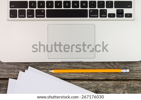 Macboock and notes with pencil  still life - stock photo
