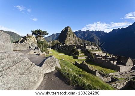 Macchu Picchu, view at the Huayna Picchu in the early morning - Aguas Calientes, Peru. - stock photo