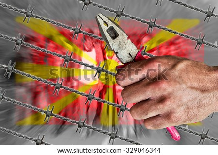 Macedonia flag, migrants and barb wire with pliers