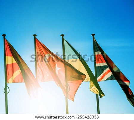 Macedonia Flag, Turkey Flag, Ukraine Flag and United Kingdom Flag on a blue clear sky in Strasbourg, France - in front of the Council of Europe - stock photo