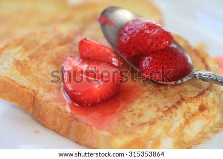 Macerated strawberries on French toast closeup - stock photo