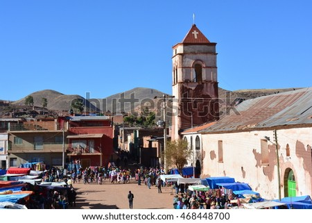 MACHA, BOLIVIA: MAY 4TH, 2016 - Nice view of the tower of the church of Macha and some unidentified people during the Tinku festival in Macha, Bolivia, on May 4th, 2016
