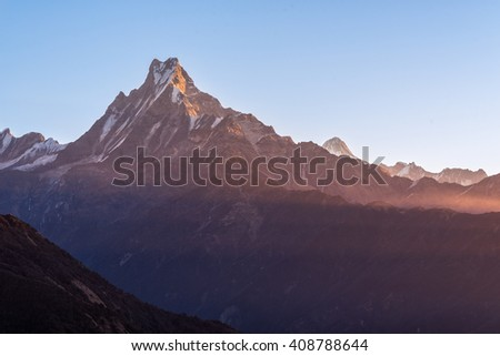 Machapuchare or Fishtail peak with sunrise sky. it is a mountain in the Annapurna Himal of north central Nepal. - stock photo