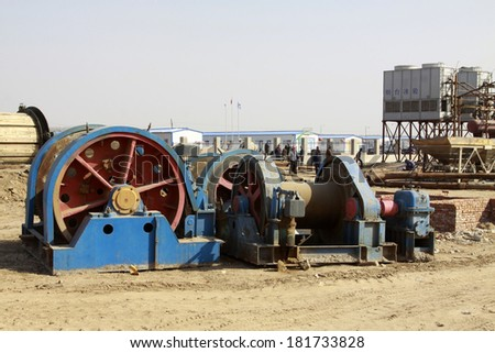 MACHENG - March 13: Winch in mining construction site in MaCheng iron mine on march 13, 2014, Luannan County, Hebei Province, China  - stock photo