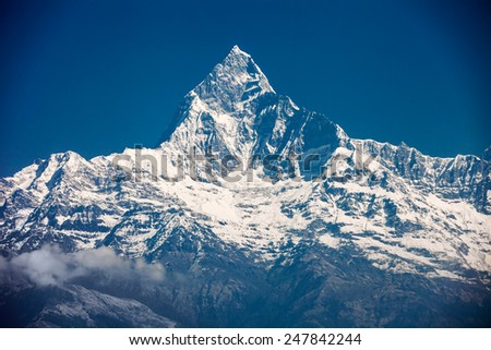 Machhapuchchhre mountain - Fish Tail in English is a mountain in the Annapurna Himal, Nepal - stock photo