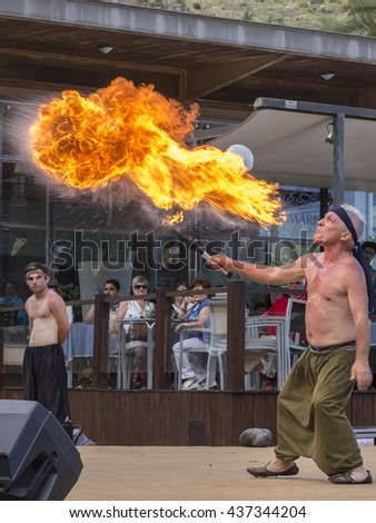 Machico,Madeira,Portugal - 05 June 2016: Fire breathing act at the 16th Century Market Fair event in Machico