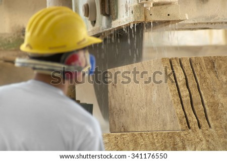 machine cutting a granite block
