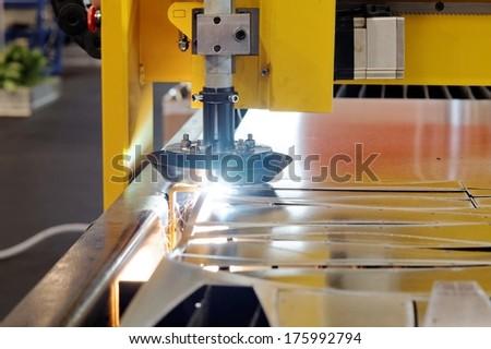 Machine cutting steel - stock photo