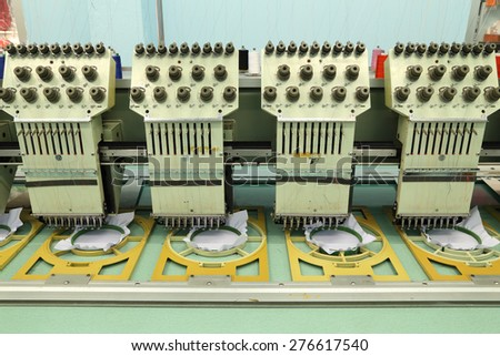 Machine embroidery is an embroidery process whereby a sewing machine - stock photo