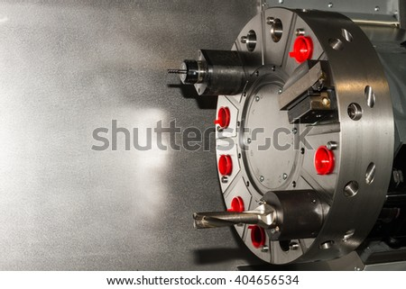 Machine equipment / tools on CNC machine for heavy industry - stock photo