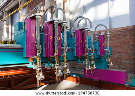 machine for cutting metal in a modern plant - stock photo