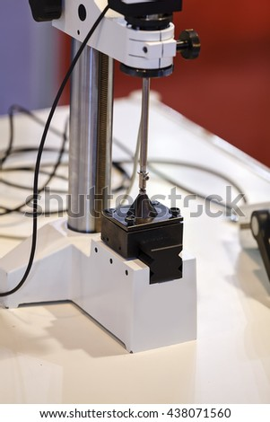 Machine for manufacture in industry, advanced technology;  note shallow depth of field