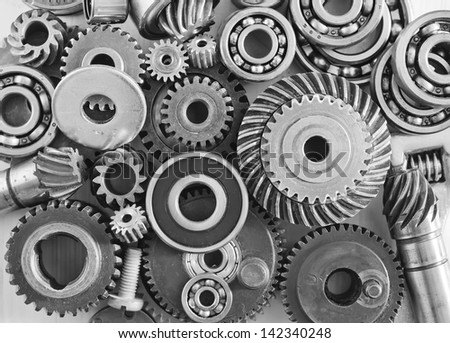 Machine gear, metal cogwheels, nuts and bolts - stock photo