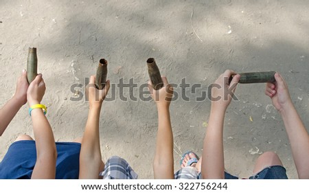 machine-gun cartridges in their hands. Social poster - stock photo