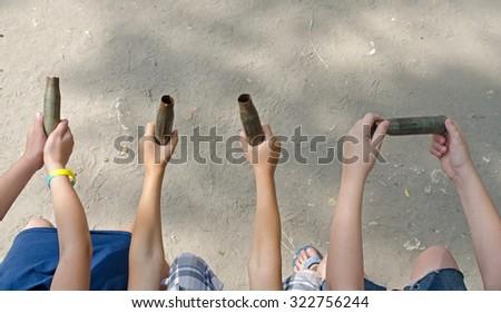 machine-gun cartridges in their hands. Social poster - stock photo
