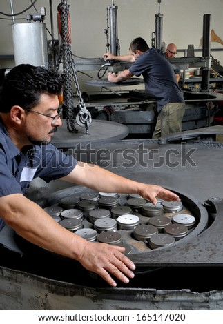Machine Shop Workers in a precision grinding shop - stock photo