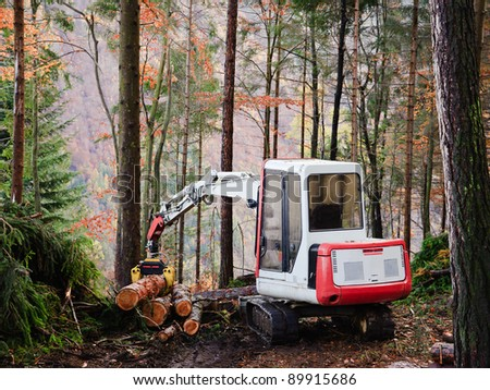 Machine tool operator to work in the forest - stock photo