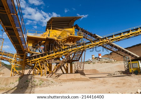 Machinery and classification according gravel size distribution via conveyor belts  - stock photo