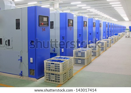 Machinery and equipment in a spinning production company, china.  - stock photo