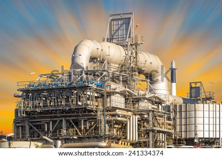 Machinery in oil refinery with sky background.