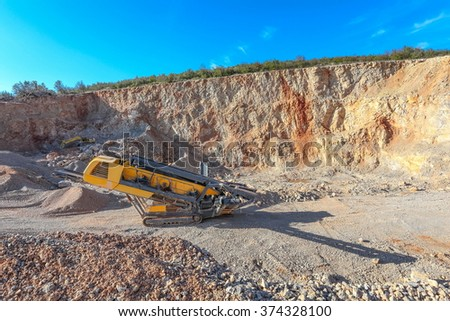 Machinery in the gravel pit - stock photo
