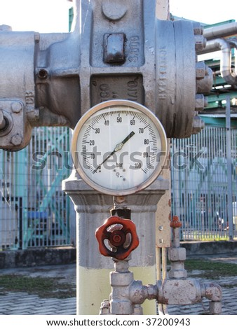 machinery under pressure  into a refinery plant - stock photo